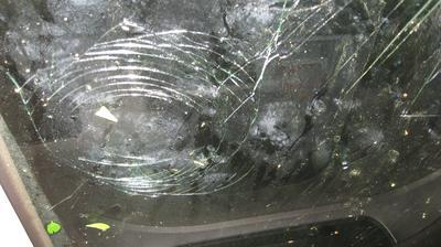 Front windshield hail damage